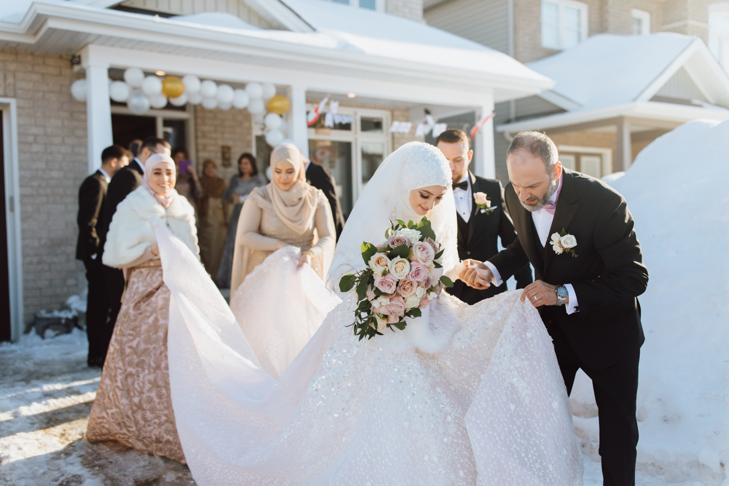 Bride leaving the house with her father